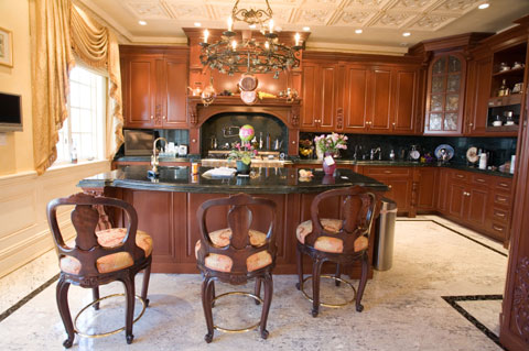kitchen island features elegant cherry wood panelled. Black Bedroom Furniture Sets. Home Design Ideas