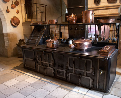 medieval styling of kitchen island for cooking with a little storage