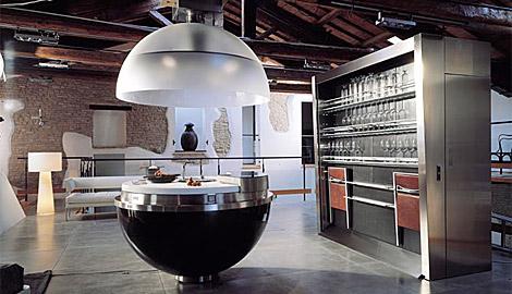 round kitchen island features over head lighting hood sink