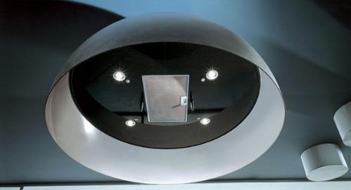 round kitchen island features over head lighting hood vent double sink